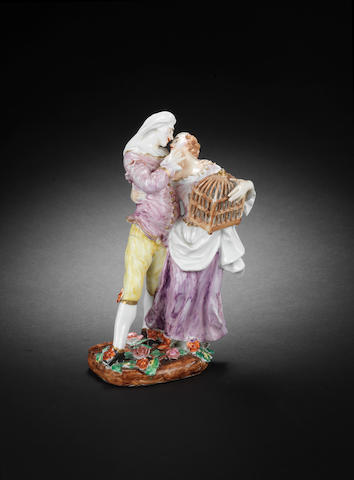 A Meissen group of Scaramouche and a lady with birdcage, circa 1740-45, later decoration