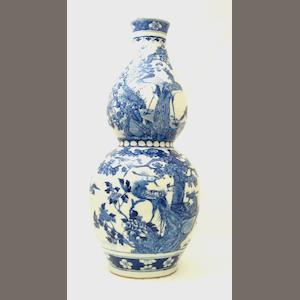 A large blue & white double gourd vase together with a famille rose jardinière