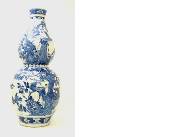A large blue and white double gourd vase together with a famille rose jardinière