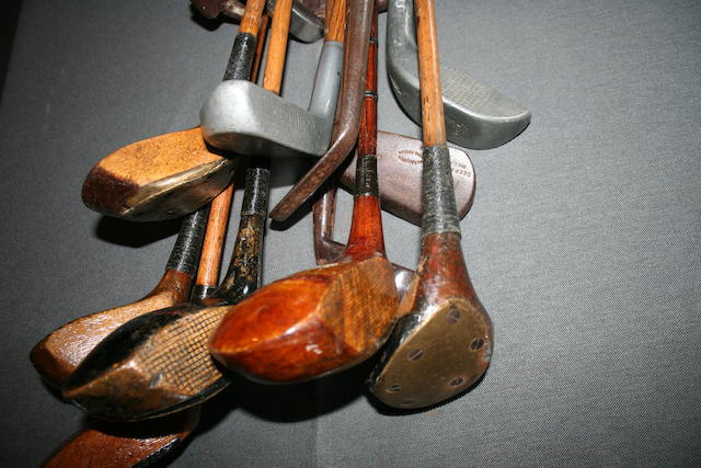 A collection of 11 wooden shafted golf clubs in a golf bag