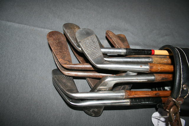 A collection of 13 wooden shafted mainly 'Carnoustie' golfing irons