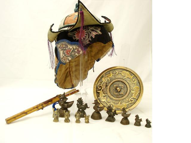 A Mongolian child's hat, chopstick set, bronze opium weights and bronze mirror Late 19th century