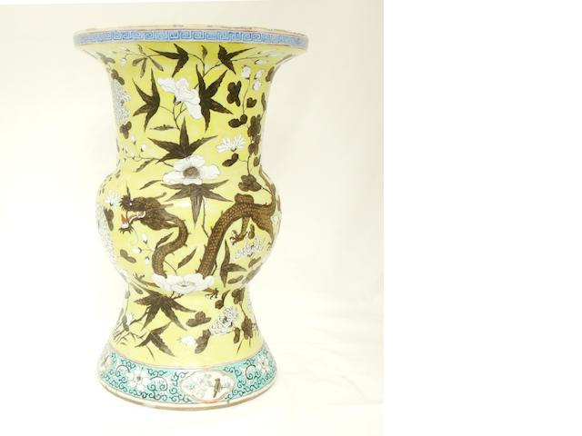 A yellow ground famille rose vase, gu Late 19th/early 20th century