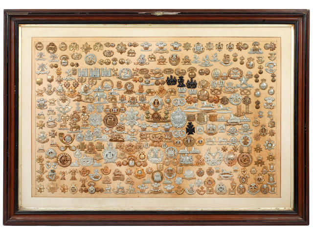 A Superb Collection of Victorian Cap & Collar Badges. Formed & Framed c1903/04