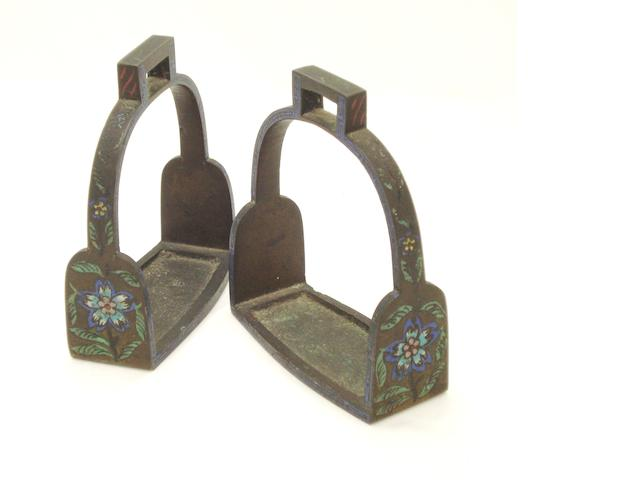 A pair of bronze and enamelled stirrups 19th Century