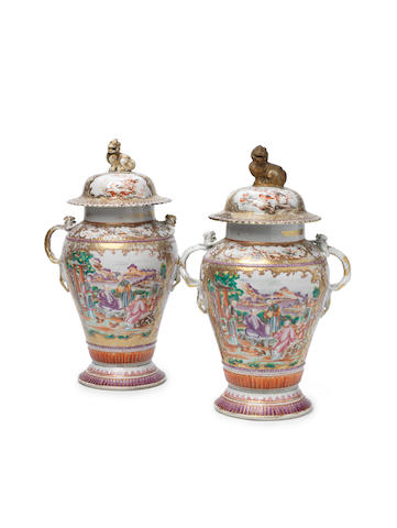 A pair of Chinese famille rose vases and covers Qianlong