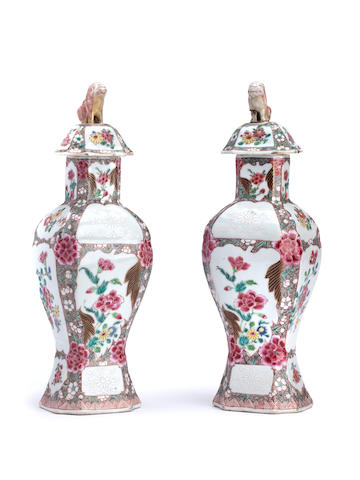 A pair of Chinese famille-rose vases and covers Qianlong