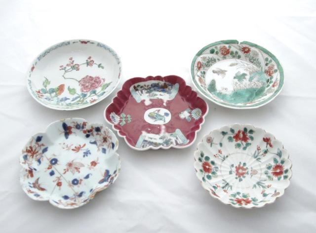 A famille verte fluted saucer and four other saucers Kangxi and later