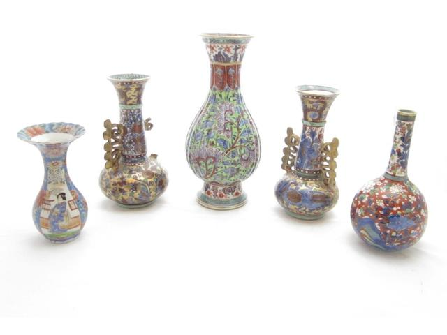 A collection of four clobbered blue and white vases