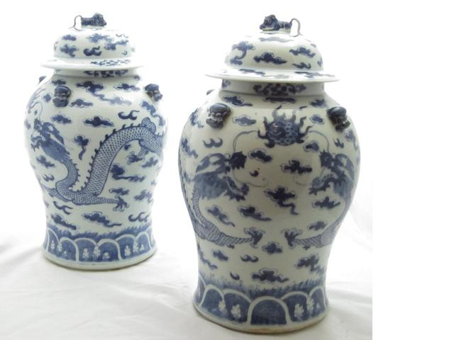 A pair of blue and white baluster vases and covers 19th century