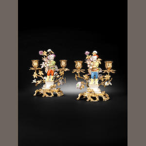 A pair of ormolu candelabra mounted with Meissen figures of 'Kammerhusar' Schindler, circa 1745