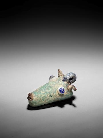 A Phoenician glass animal head pendant