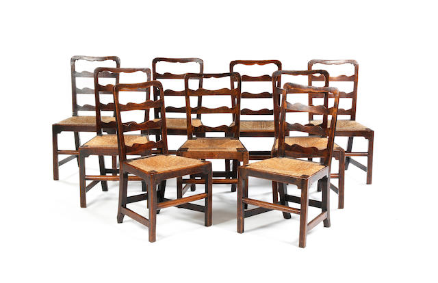 A set of nine George III oak ladder back dining chairs Of unusual form