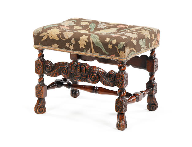A late 17th century style beech and upholstered stool