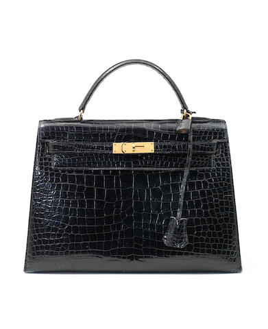 A black crocodile hermes kelly bag for examination by Claire Browne