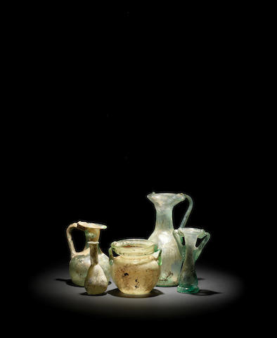 Five Roman pale green glass vessels 5