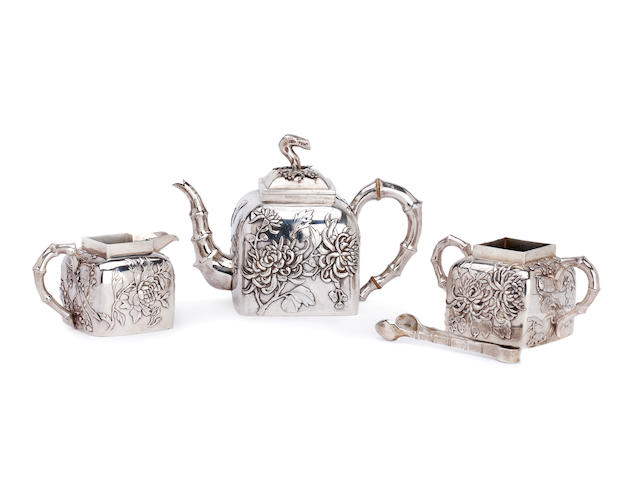 A Chinese silver three piece tea service By Wang Hing, and tongs, (4)