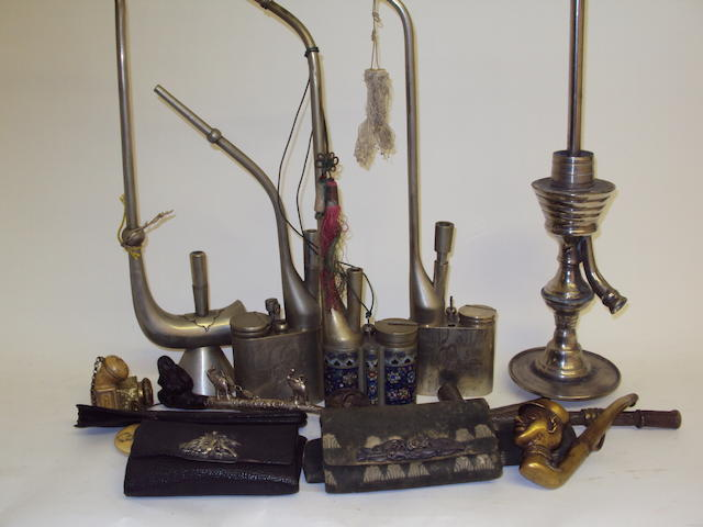 A collection of metal smoking pipes