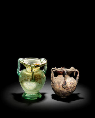 Two Late Roman glass jars with multiple handles