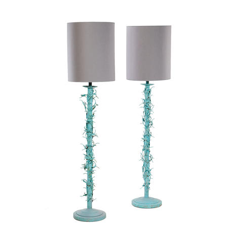 A pair of 1960s green patinated metal standard lamps