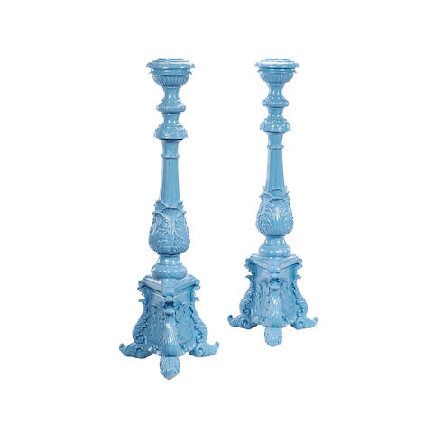 A pair of blue painted fibreglass candle standsin the 19th century style