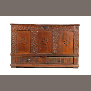 An unusual early 17th century oak and inlaid mule chest