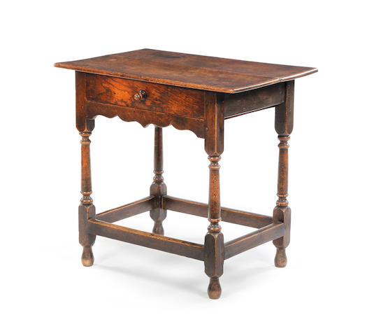An early 18th century oak and elm side table
