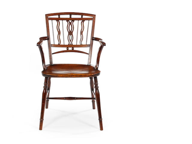 A 19th century fruitwood and elm Mendelsham armchair East Anglia, circa 1800-1860
