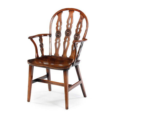 An early 19th century yew and elm Windsor Armchair Attributed to the Prior Family workshop, Buckingham