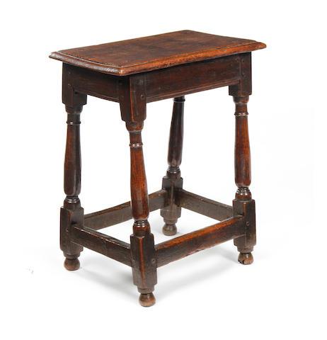 A 17th century oak joint stool