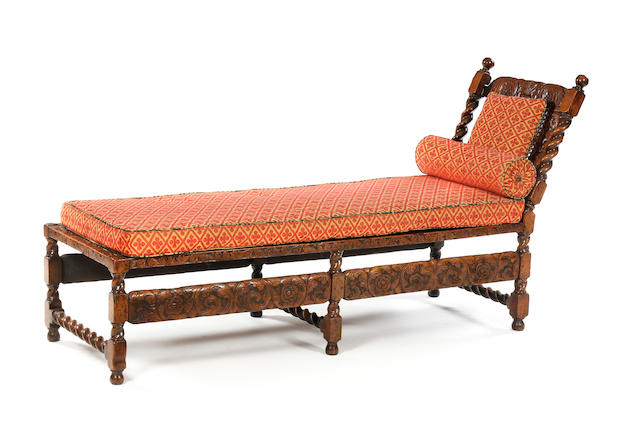 A Charles II style walnut and cane day bed