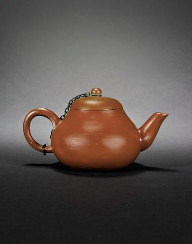 A small Yixing teapot and cover Four-character impressed mark