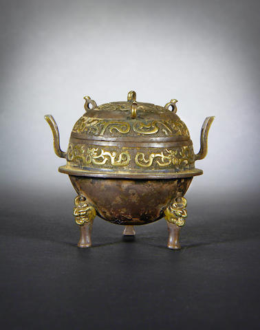 A small parcel-gilt and metal incense burner and cover