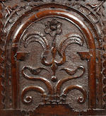 A James II large carved oak boarded chest, dated