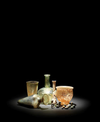 Five Roman glass vessels and fifteen small glass items, 20