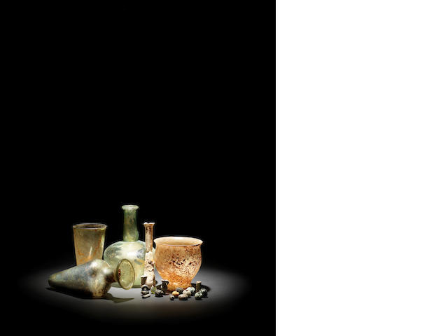 Five Roman glass vessels, a group of beads and miniatures Byzantine vessels