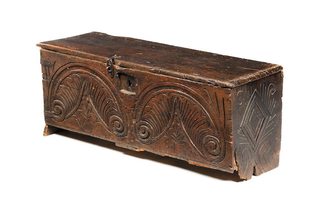A Queen Anne oak boarded chest, dated