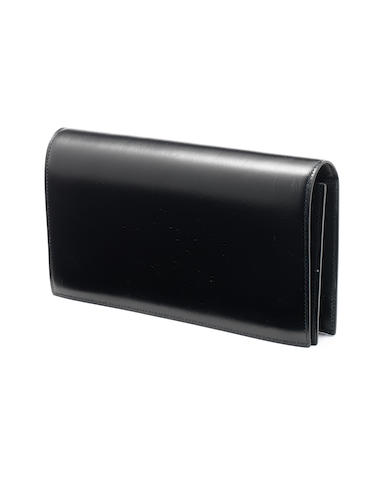 An Hermès black leather clutch bag