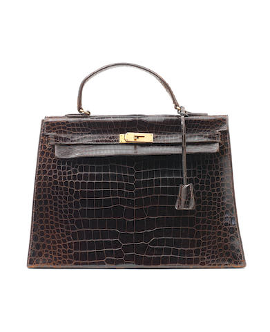 An Hermès dark brown crocodile Kelly bag, 1960s