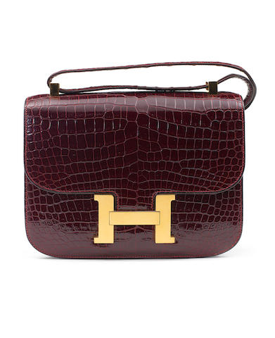 An Hermès deep burgundy crocodile Constance bag, 1975