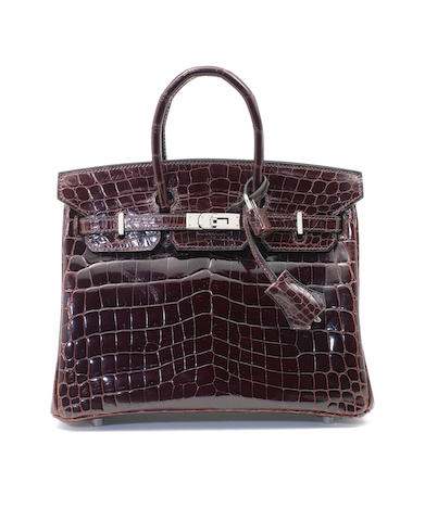 An Hermès dark brown crocodile Birkin bag, 2009