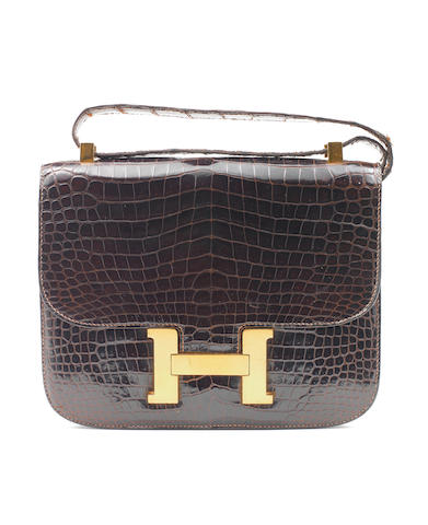 An Hermès dark brown crocodile Constance bag, 1973