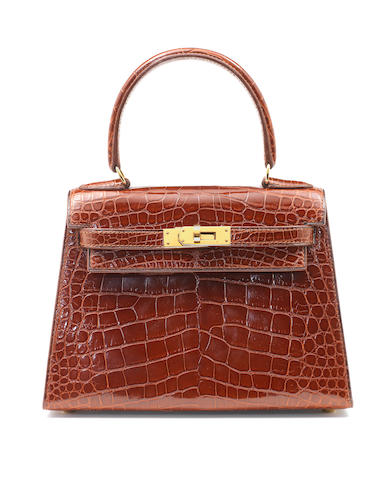 An Hermès rust brown crocodile mini Kelly bag, 1993