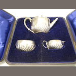 A bachelor's three piece cased silver tea service by J.Bradbury & J.Henderson, London 1881/2