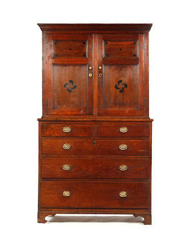 A 19th century oak and grain simulated livery cupboard Welsh