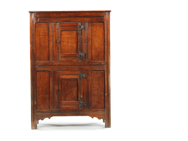 A 17th century oak livery cupboard