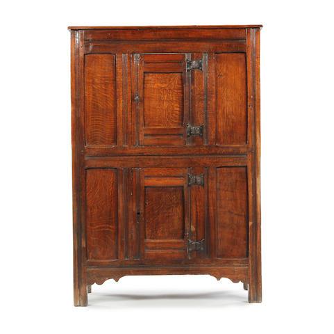 A 17th century oak livery cupboard