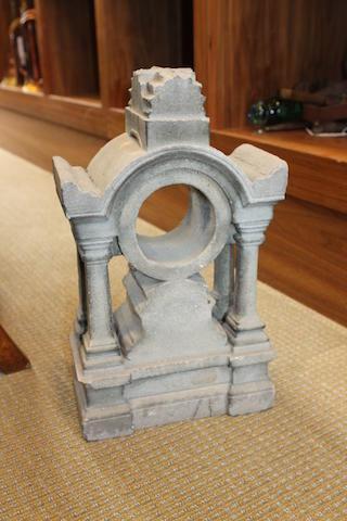 A composition stone sun dial