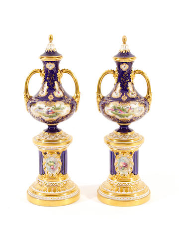 A pair of Royal Worcester pedestal vases with covers, dated 1898