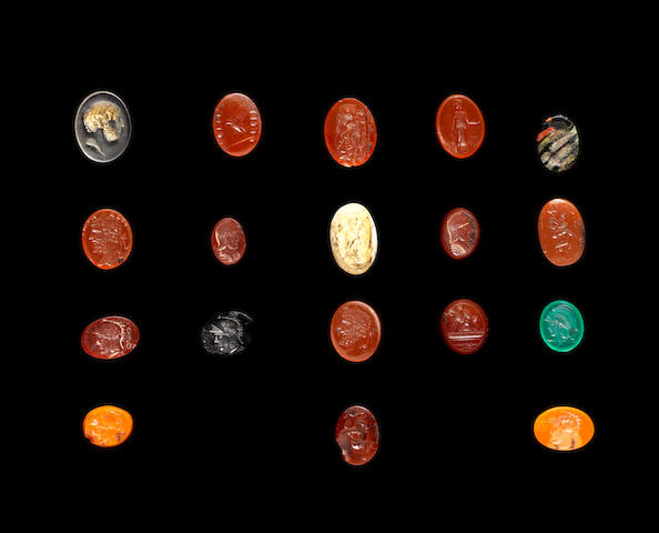 A collection of cast glass Neo-Classical intaglios